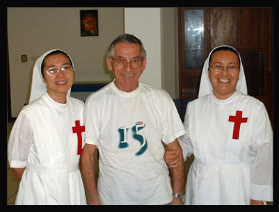 Fr. Crescenzo Mazella with Sr. Thipowan Taolin (left) and Sr. Ruby Chua (right)
