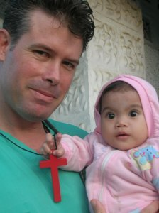 Fr Scott and Putri in Nias, Indonesia before her heart surgery